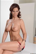 Syren De Mer fucks a stud on the kitchen counter Picture 07
