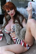 Taylor Wane sucks big black cock in her sexy swimsuit