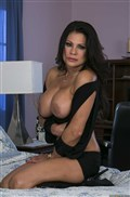 Teri Weigel gets fucked in bed after masturbating herself